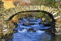 High Sweden bridge. In near Ambleside in the English Lake District. A fine example of an old packhorse bridge Stock Photos