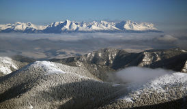 High Tatras from Chopok in winter. High Tatras from peak Chopok (Low Tatras) in winter. Panorama stock photography