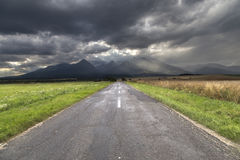 High Tatras with dramatic sky. Road to high Tatras with dramatic sky Stock Photo