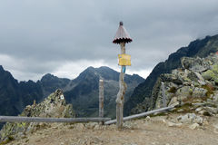High Tatras - pointer. High Tatras's mountains - Lomnicky's peak mountain - pointer above the precipice Stock Images