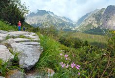 High Tatras (Slovakia) summer view and family on footway. stock image