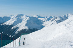 High Tatras in the snow. High Tatras in the snow and the tourists Royalty Free Stock Photo