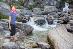 High Tatras - Studenovodske waterfalls and young girl Royalty Free Stock Images