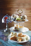 High tea. A serving bowl with sweets and cookies for a high tea Royalty Free Stock Photography