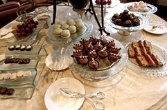 High tea: cakes and biscuits. Buffet presentation with traditional asian sweets Stock Photography