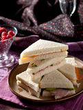 High tea sandwiches. Delicious sandwiches with cucumber and with salmon Stock Image