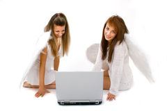 High Tech Angels. Two angels working together on a computer to keep track of their assignments Stock Photo