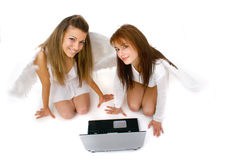 High Tech Angels. Two angels working on a computer to keep track of their assignments Royalty Free Stock Images