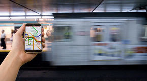 High-Tech Daily Commute. High-Tech solution to Navigating the Subway system stock photography