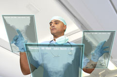 High-tech doctor. Doctor in uniform with high-tech screen in the hospital Royalty Free Stock Photo