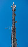 High-Tech Electronic Communications Tower. On blue sky background Stock Images