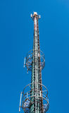 High-Tech Electronic Communications Tower. On blue sky background Stock Photography
