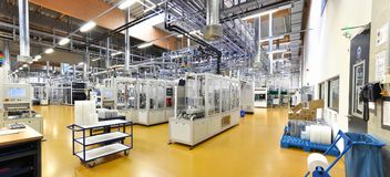 High tech factory - production of solar cells - machinery and in. Teriors Royalty Free Stock Photos