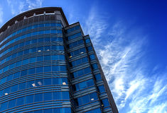 High tech highrise building. An illustrating highrise building with clear blue sky as background Royalty Free Stock Photos