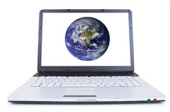 High tech laptop. With globe on screen, shot with wide angle lens, world from nasa.gov Royalty Free Stock Photography