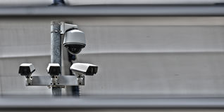 High tech overhead security camera system in guarded area. High tech overhead security camera system installed in guarded industrial area stock photo
