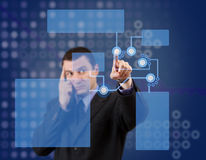 High tech panel. Businessman pressing high tech panel on a virtual background Stock Photos