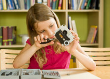 High Tech Tinker. School girl busy with tools and mechanism Stock Photos