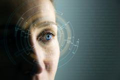 High Technologies in the future. Young woman`s eye and high-tech concept, augmented reality display, wearable computing. In a natural light stock image