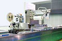 High technology and modern new automatic food or other packing and labeling machine with plastic film coil for industrial. Commercial royalty free stock photography