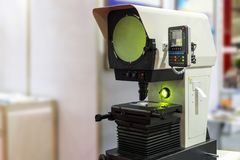High technology and modern of profile projector or optical comparator for silhouette precision measuring and quality control of. Small parts in industrial stock images