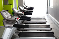 High technology motorized Treadmils in a row. High technology motorized Treadmills in a row (using shallow depth of field Stock Image