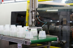 High technology Plastic cup manufacturing industrial Stock Photos