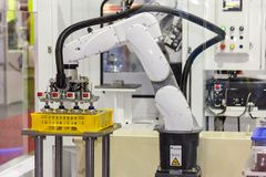 High technology of precision and accuracy industrial robot arm during working put glass bottle in plastic box with automatic royalty free stock images