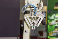 High technology and precision robot arm with grip for catch product  in manufacturing process stock photo