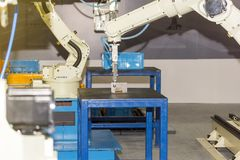 High technology and precision robot arm with grip during catch welding part in manufacturing process.  royalty free stock images