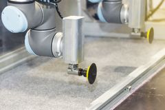 High technology and precision robot grip with automatic vacuum for catch glass plate or product in manufacturing process.  royalty free stock photography