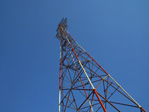 High television antenna on a background of the blue sky. Tallest structure with electricity Stock Photography