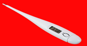 High temperature. Thermometer with high temperature on red background Stock Photos