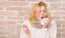High temperature concept. Woman feels badly ill. How to bring fever down. Fever symptoms and causes. Sick girl with. Fever. Girl hold thermometer and tissue stock images