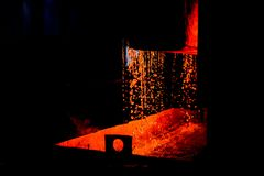 High temperature in the melting furnace. Metallurgical industry. Heavy forging Plant.Oven. Water curtain. For abstract background and texture royalty free stock images
