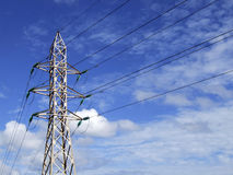 High Tension. Powerline cables and supporting tower structure Stock Image