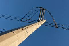 High Tension. Strong compositional lines are created by the detail of a high tension line tower Stock Photos