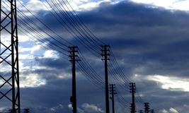 High tension. Tower at dusk going to the horizont Royalty Free Stock Photos