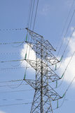 High tension eclectic power tower. On ground outdoor royalty free stock photography