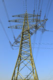 High tension electrical power. Low angle view of high tension electrical power lines and pylon tower Stock Photo