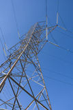 High Tension Electrical Tower. Perspective of a high tension line Stock Image