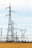 High-tension line. High tension towers near a power distribution station Stock Images