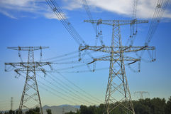 High-tension line and Transformer. Over white cloud Stock Photo