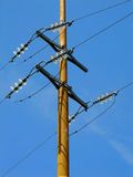 High Tension Power Line. Towards blue Sky royalty free stock photography