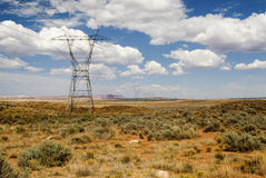 High tension power lines. Traverse the desert Stock Photo