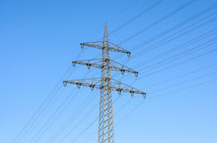 High tension power lines in sky Royalty Free Stock Image