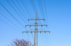 High tension power lines in sky Royalty Free Stock Photo