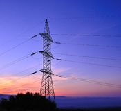 High tension tower on colorful sky at dawn Royalty Free Stock Image