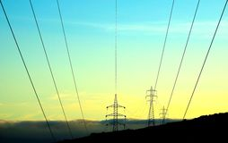 High tension towers and hanging cables Royalty Free Stock Images