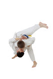 High throw judo are training boys in white kimono. Throw judo are training boys in white kimono royalty free stock photo